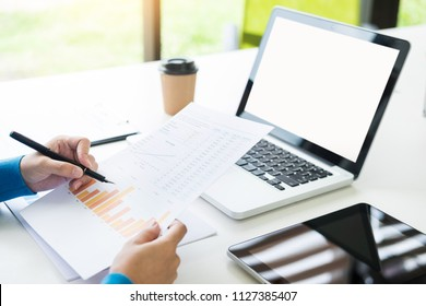 business woman with laptop, Business team working on a new business plan with modern digital computer, finance graph and writes on a document at her office.