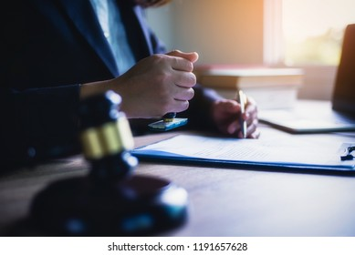 Business woman or lawyer sitting with hand holding stamp approve important contract in office. Legal law and justice concept.