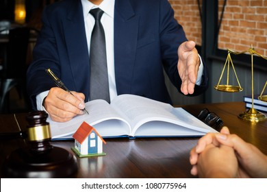 Business woman and lawyers discussing contract papers with brass scale on wooden desk in office. Law, legal services, advice, Justice concept.