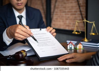 Business woman and lawyers discussing contract papers with brass scale on wooden desk in office. Law, legal services, advice, consult, Justice concept.