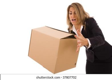 Business woman let falling a cardboard box