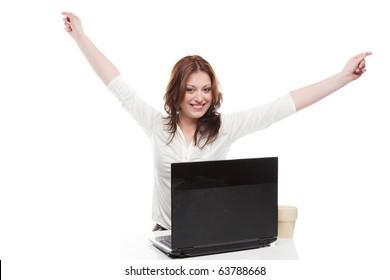 Business woman looking at camera gesturing success at winning