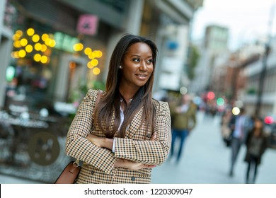 Business woman looking concerned with crossed arms