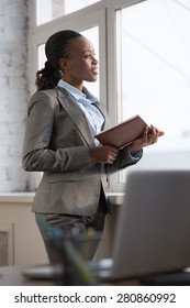 Business woman looking at her schedule during break at office
