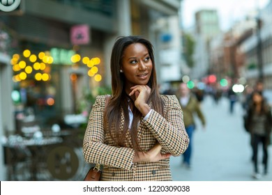 business woman looking thoughtful