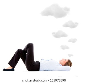 Business woman lying down daydreaming - isolated over white background