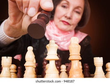 business woman making a move in a chess game