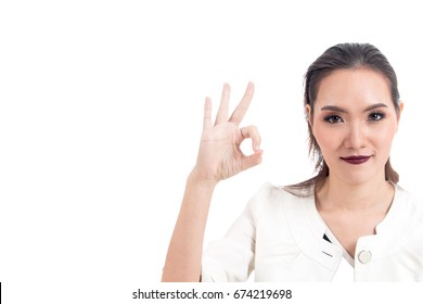 Business woman making OK sign isolated on white background