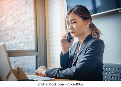 Business Woman making a phone call with smartphone. Workplace strategy Concept.
