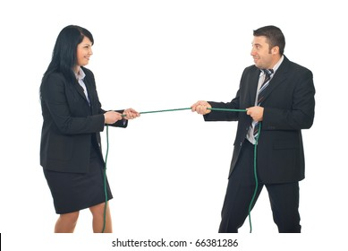 Business woman and business man in competition pulling a rope isolated on white background