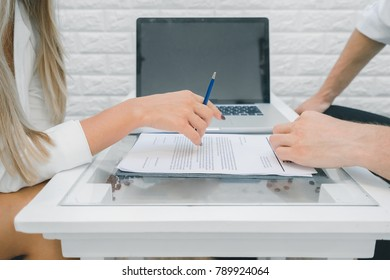 Business woman and business man discuss document on new contract, business woman holding pen will be signing, business concept