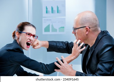 business woman and business man fighting facing each other