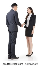 Business woman and man shake hands, full length portrait isolated on white background.