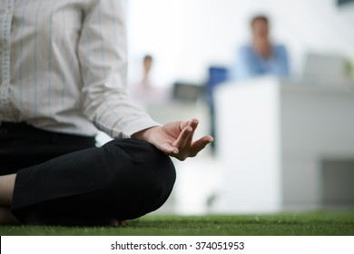 Business woman meditating in the office