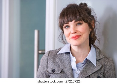 Business woman in modern office hand on hip