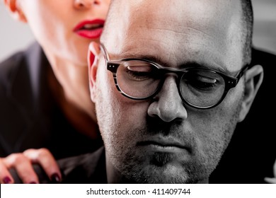 business woman molests an office worker in their workplace