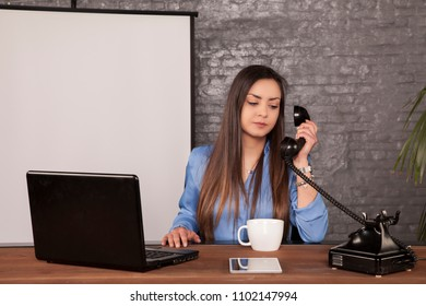 business woman is negotiating with a landline phone