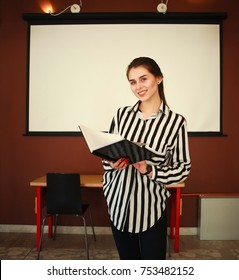 Business woman with notebook stand in office with white board presenting in meeting room