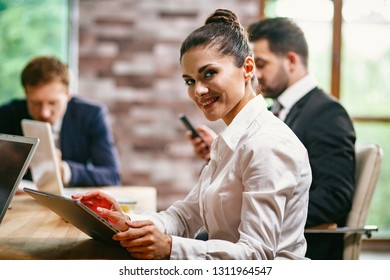 Business woman in the office with colleagues discuss business meeting. woman viewing documents. close-up shot