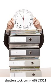 Business woman in office with folder stacks is under time pressure.
