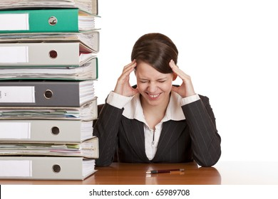 Business woman in office has migraine because of stress. Isolated on white background.
