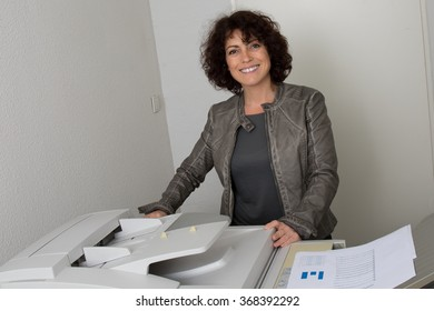 Business woman in office working on printer isolated