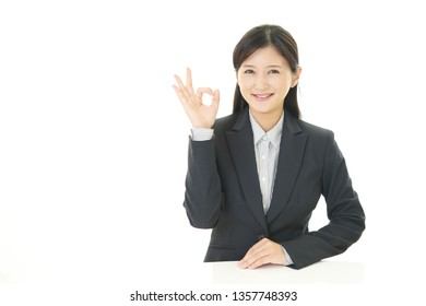 Business woman with ok hand sign.
