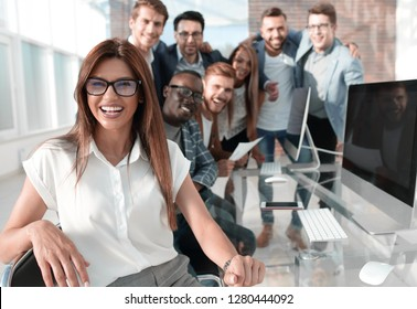 business woman on the background of the business team