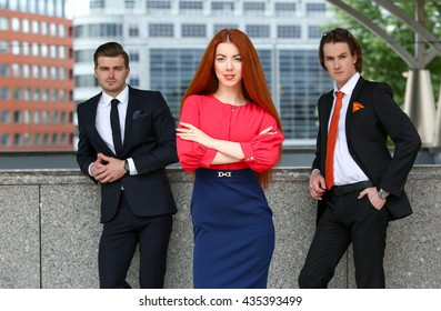 Business woman on the background of two men