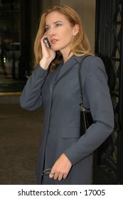 Business woman on cell phone wearing blue suite