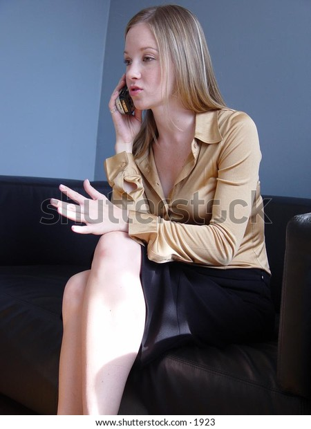Business woman on cell phone.