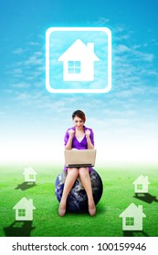 Business woman on grass field and present the House icon : Elements of this image furnished by NASA