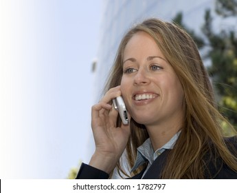 A business woman is on her cell phone.