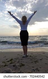 business woman on a sea beach