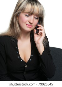 The business woman on the workplace talks by the mobile phone. It is isolated on the white background.