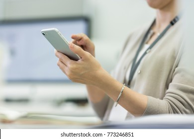 Business woman operating a smartphone