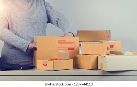 Business woman owner packing cardboard boxs to shipment Customer.shopping online and delivery service concept.