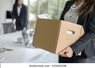 Business woman packing her belonging after resign or be fired from business company