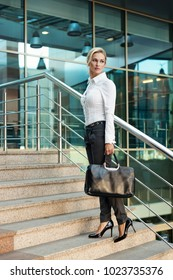 Business woman in pants with briefcase