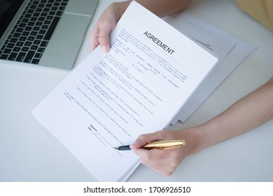 Business woman and partner sign a contract investment professional document agreement in meeting room.