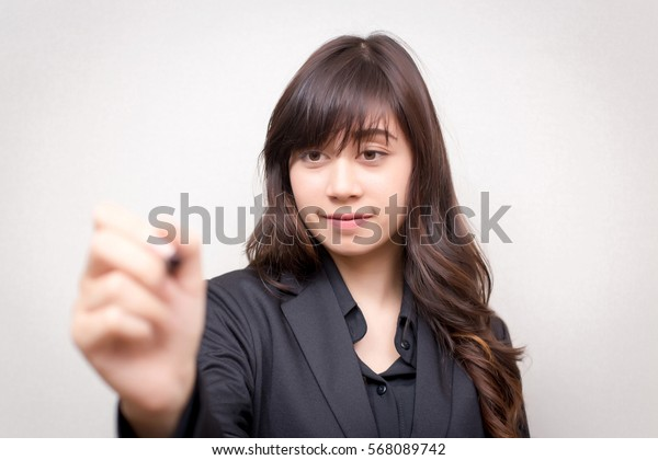 Business woman with a pen. concept for business.