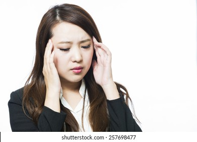 Business woman physically uncomfortable headache