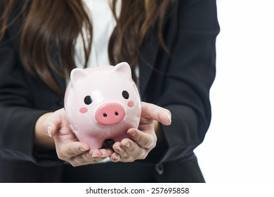 Business woman with a piggy bank to get hold dollars, is a savings concept