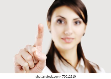business woman pointing at something on screen