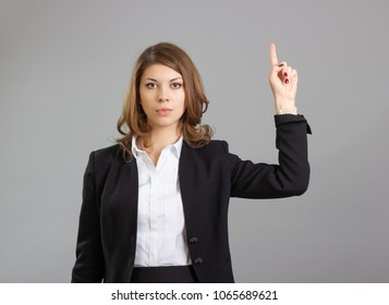 Business woman pointing up at something in space.
