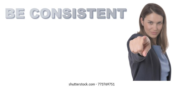 Business Woman pointing the text BE CONSISTENT Business Concept.