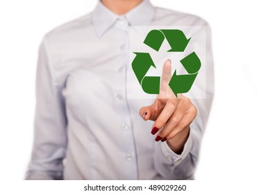 Business woman with pointing or touching a touch screen on white background. Conceptual image, help and care for recycling. Two hands business women isolated on white with recycle icon in the middle.