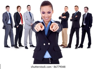 business woman pointing to you and choosing for her team