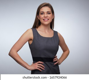 Business woman portrait in gray dress. isolated studio portrait.