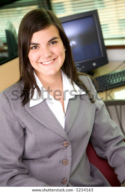 business woman portrait in her office by a computer